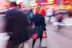 Shopping woman in the city. Picture of a shopping woman on the move in the city at night, in motion blur Stock Photography