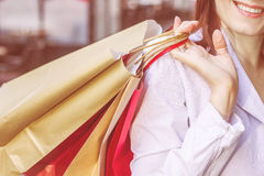 Shopping Woman. Close up of Shopping Woman holding colorful bags. Caucasian unrecognizable female on street Royalty Free Stock Photo