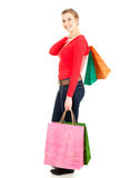 Shopping woman with colourful bags, full lenght Royalty Free Stock Photos