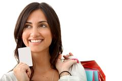 Shopping woman with credit card Stock Photos