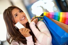 Shopping woman with a credit card Royalty Free Stock Photos