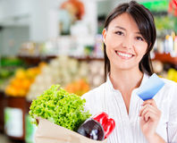 Shopping woman with credit card Stock Photography