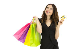 Shopping woman with a credit card looking to copy space Stock Photography