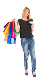 Shopping woman with credit card standing Stock Images