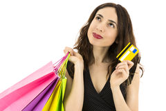 Shopping woman with a credit card thinking Stock Image