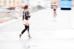 Shopping woman crosses the street Stock Photos