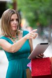 Shopping Woman with Digital Tablet Royalty Free Stock Photos
