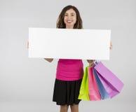 Shopping woman displaying banner Royalty Free Stock Photos