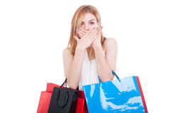 Shopping woman doing speak no evil gesture. On white studio background Stock Images