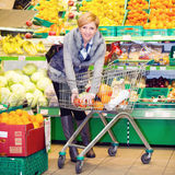 Shopping. Woman doing shopping in a supermarket Stock Photography