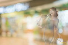 Shopping woman. Double exposure of shopping woman in the mall royalty free stock photography