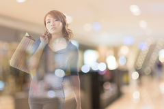 Shopping woman. Double exposure of shopping woman in the mall royalty free stock images