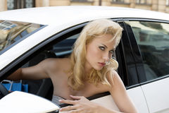 Shopping woman driving car Stock Photography