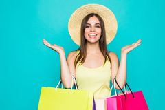Shopping. Shopping woman excited dynamic image of young woman with shopping bags. Isolated on color background. Shopping woman excited dynamic image of young Stock Photo