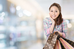 Shopping woman. Exciting young shopping woman hold bags, closeup portrait with copyspace Stock Photography