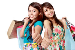 Shopping woman friend showing thumb up Stock Photos