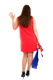 Shopping woman gives a wave goodbye Royalty Free Stock Image