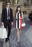 Shopping woman and helper man Royalty Free Stock Photo
