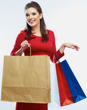 Shopping woman hold bags, portrait isolated. White background. Stock Photos