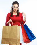 Shopping woman hold bags, portrait isolated. White Royalty Free Stock Photos