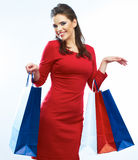 Shopping woman hold bags, portrait . White background. Stock Photography