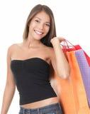 Shopping woman holding bags. Shopping. Beautiful shopping woman on white Royalty Free Stock Photo