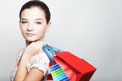 Shopping woman holding bags Stock Images