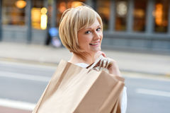 Shopping woman holding bags Royalty Free Stock Images