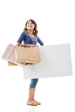 Shopping woman holding bags and blank board Stock Photos