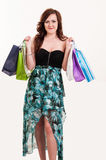 Shopping woman holding bags, she is happy Royalty Free Stock Photo