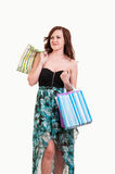 Shopping woman holding bags, isolated on white background Stock Photos