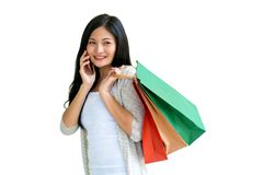 Shopping woman holding bags isolated on white background, consum stock photos