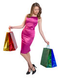 Shopping woman holding bags, isolated on white Royalty Free Stock Photo