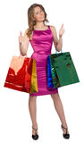 Shopping woman holding bags, isolated on white Royalty Free Stock Photography
