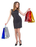 Shopping woman holding bags, isolated on white Stock Photography