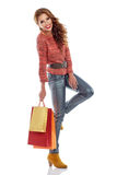 Shopping woman holding bags, isolated on white Royalty Free Stock Photos