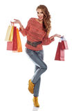 Shopping woman holding bags, isolated on white Stock Photos