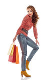 Shopping woman holding bags, isolated on white Royalty Free Stock Images