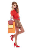 Shopping woman holding bags, isolated on white Royalty Free Stock Image