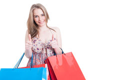 Shopping woman holding bags and showing double like gesture Royalty Free Stock Photo