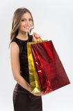 Shopping woman holding bags  on white background. Royalty Free Stock Photography