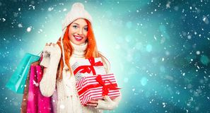 Shopping woman holding color bags and gift box on winter background with cnow in black friday, Christmas and New Year Stock Photos