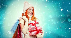 Shopping woman holding color bags and gift box on winter background with snow in black friday, Christmas and New Year Royalty Free Stock Photos