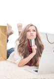 Shopping woman holding credit card and thinking Stock Photo