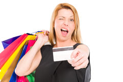 Shopping woman holding credit card and wink Royalty Free Stock Image