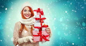 Shopping woman holding gift boxes on winter background with snow in black friday, Christmas and New Year holidays. Sale Royalty Free Stock Photography