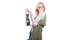 Shopping woman holding paper bags looking one side Royalty Free Stock Photography