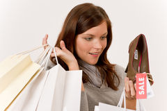 Shopping - woman holding shoes and bags Royalty Free Stock Images