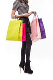 Shopping woman holding shopping bags. Closeup of beautiful women colorful shopping bags. Isolated on white. Royalty Free Stock Photo