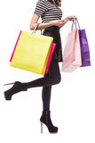 Shopping woman holding shopping bags. Closeup of beautiful women colorful shopping bags. Isolated on white. Royalty Free Stock Images